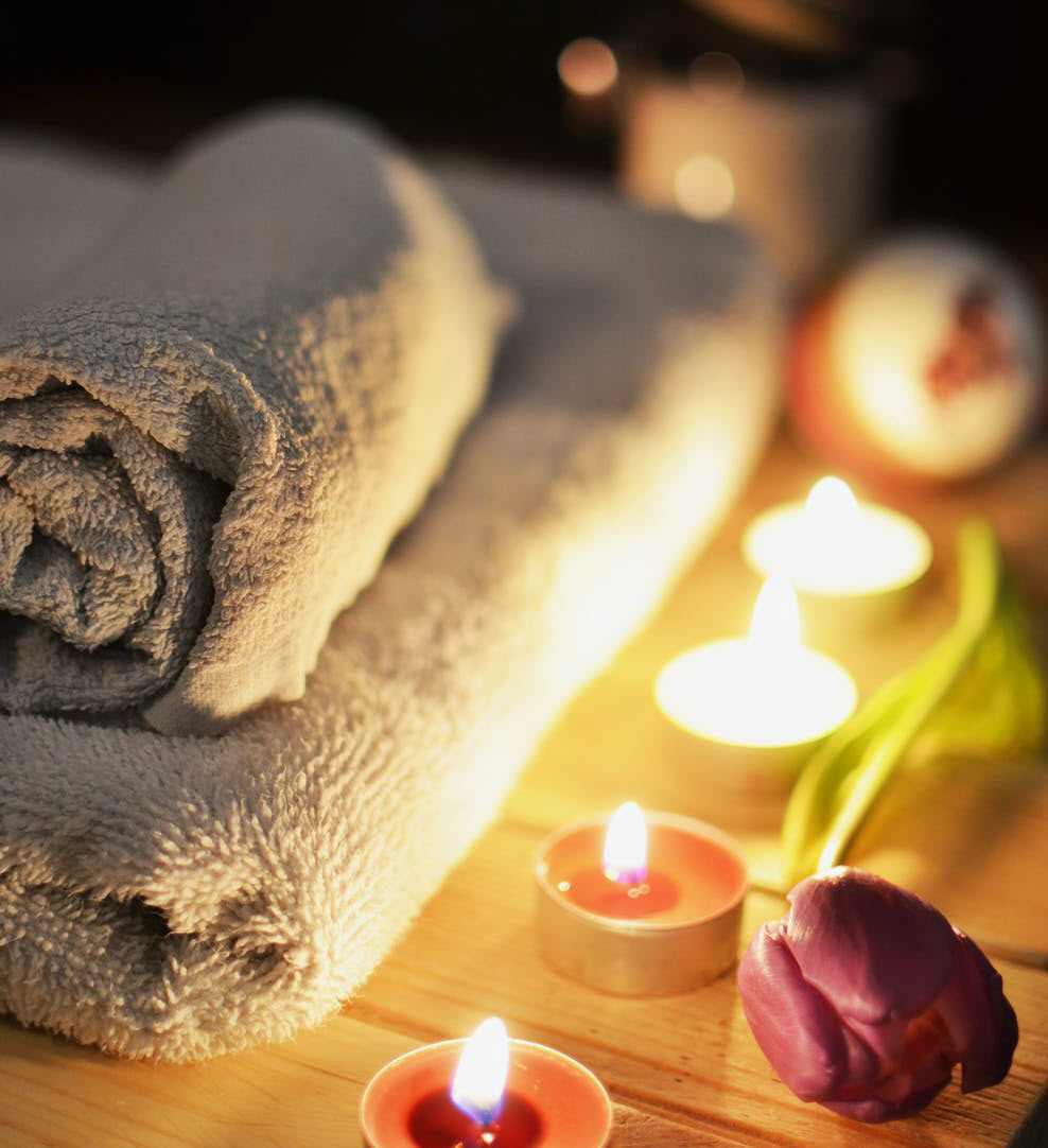 spa-massage-towels-flower-candles-aromatherapy