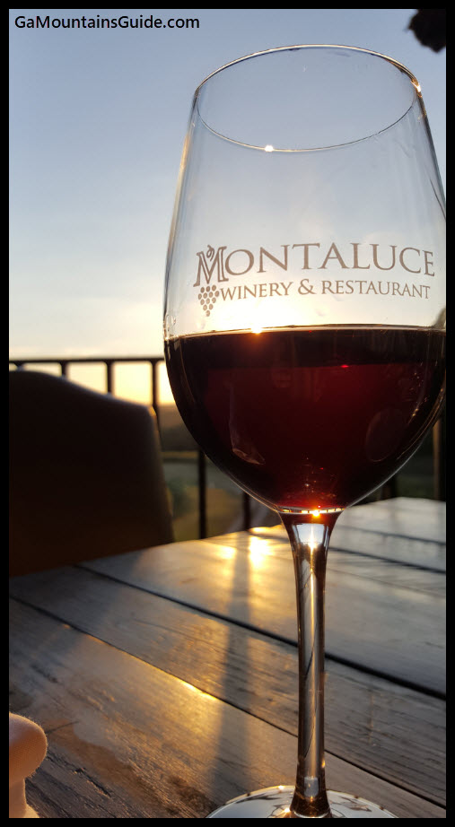 Montaluce - Glass of Red Wine - GaMountainsGuide.om