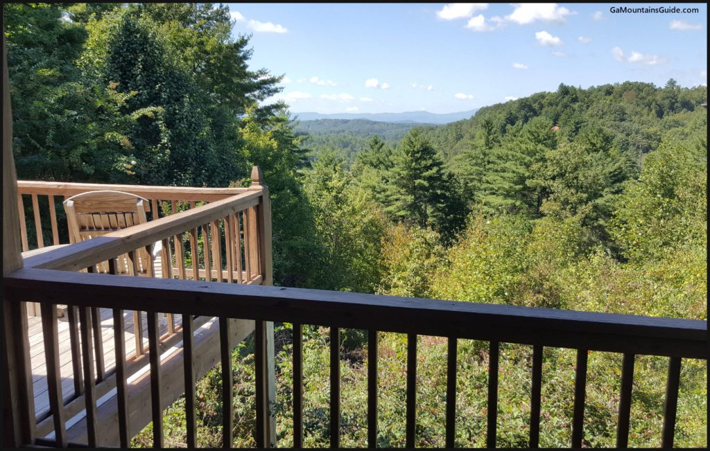 Above the Rest Cabin Deck w/ Rocking Chairs & Mountain Views - GaMountainsGuide.com