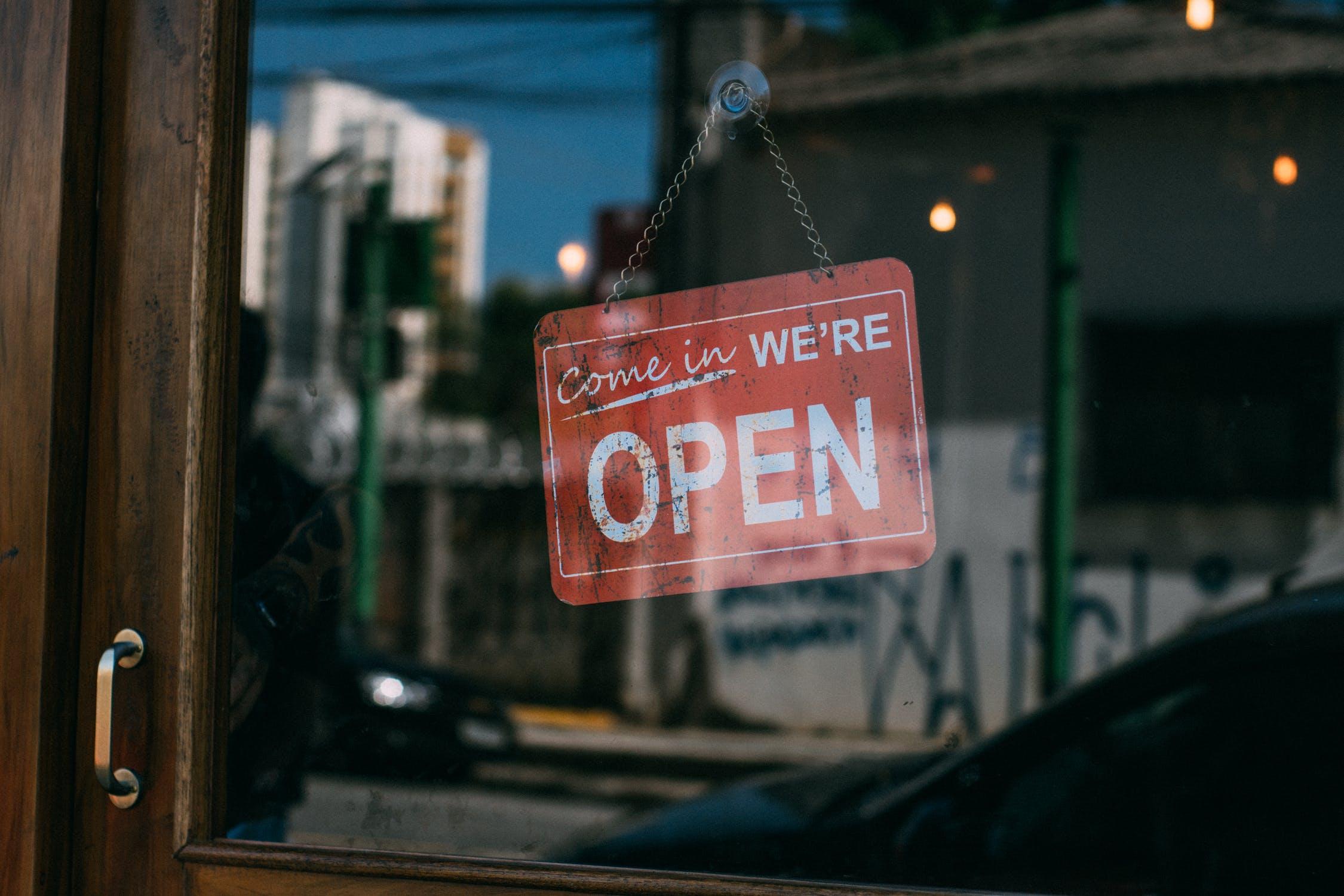 store-front-door-sign-come-in-were-open